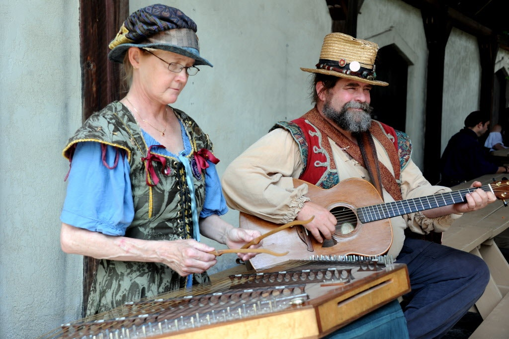 Christina Potter and Jim Hancock play traditional folk music for guests at the Royal Ale Festival at Scarborough Renaissance Festival in Waxahachie, TX on April 27, 2014.