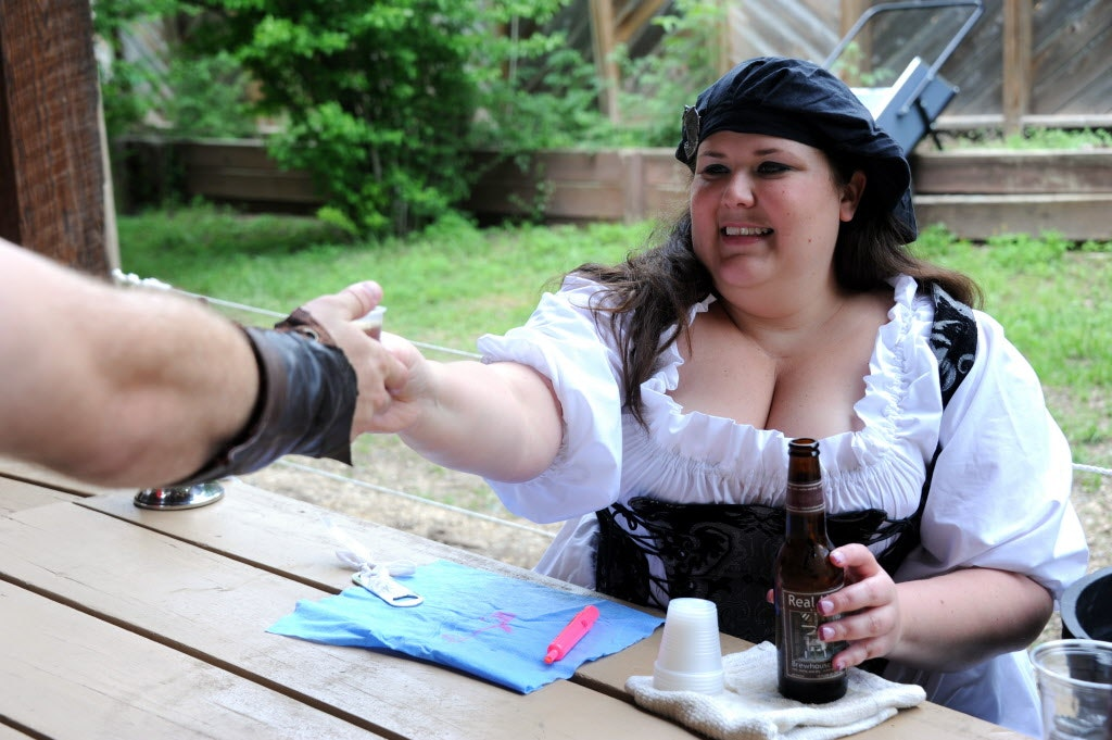 Jessica Bednar serves Brewhouse Brown beer at the Royal Ale Festival at Scarborough Renaissance Festival in Waxahachie, TX on April 27, 2014.