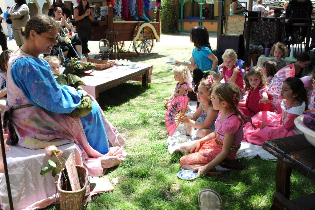 Children's story teller Angela Hunt, aka The Painted Lady, provides dress-up costumes for the kids while telling stories at Scarborough Renaissance Festival in Waxahachie, TX on April 14, 2013.