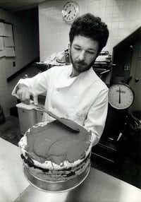 Stephan Pyles icing a cake in his kitchen at Routh Street Cafe on December 10, 1983   (File)