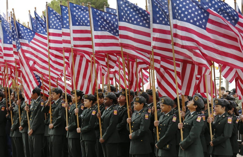 From Dallas GuideLive: Dallas area ROTC squads hold dozens of American flags in formation as they kick off the festivities on Veterans Day in 2014.